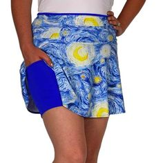 """Romance SwingStyle ove is in the air with this medium-weight artsy beauty! The blue and yellow swirls, an exclusive SparkleSkirts fabric design, covers deep periwinkle undershorts that are guaranteed not to ride up and hold two 5x5"""" pockets. There's even more storage for your phone, gels, and other training essentials within the 12"""" zippered waistband compartment that can be worn front or back. Experience SparkleSkirts, experience amour!"""
