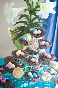 really cute centerpiece with a cupcake stand{decorated with birds nests and candy eggs}.