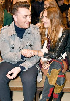 Sam Smith and Cara Delevingne bonded at the Burberry Prorsum show during London Fashion Week on Feb. 23.