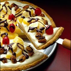 Banana Split Dessert Pizza Ingredients Crisco® Original No-Stick Cooking Spray 1 oz.) can Eagle Brand® Sweetened Condensed Milk cup sour cream 6 tablespoons lemon juice, divided 1 teaspoon vanilla extract cup butter, Just Desserts, Delicious Desserts, Dessert Recipes, Yummy Food, Dessert Pizza, Eat Dessert First, Cheesecakes, Yummy Treats, Sweet Treats