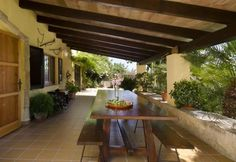 This is a traditional farmhouse-style villa surrounded by colourful tropical gardens. It's in a great location halfway between the historic town of Pollenca, and the Alcudia area. It's a family home designed in traditional style with tiled floors, white walls and Mallorcan dark-wood furniture.   On the ground floor we can find the lounge and dining room with comfortable sofas, satellite tv and a DVD player. Double doors lead out onto the front covered terrace overlooking the pool and…