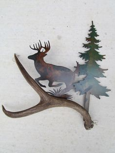 "HIGH COUNTRY DESIGNS ANTLER ART Approximately 15 1/2­­­"" high and 15"" wide, this Beautiful Rustic Wall Art is made of Authentic Deer Antler, and Precision Cut Metal. Enhance your decor with the additi"