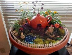 Container fairy gardens | darling tea pot house!
