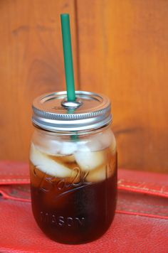 Mason Jar To-Go Cups With a few simple steps, you can turn mason jars into nifty to-go cups.