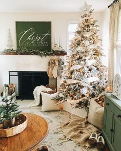 Farmhouse Christmas decor with fireplace mantle and queen flicked tree. Neutral Christmas holiday decor with white tree box. Green, gold, white, and great holiday decor Christmas Living Rooms, Christmas Room, Christmas Tree Themes, Cozy Christmas, Beautiful Christmas, Christmas Holidays, Living Room Holiday Decor, Cool Christmas Decorations, Xmas