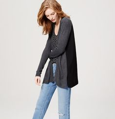 This cozy open cardigan gets extra flowy with the textural twist of a pleated woven back. Open front. Long sleeves. Pleated woven back. Split sides. Ribbed placket, hem and cuffs.