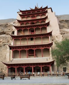 MOGAO CAVES, DUNHUANG, GANSU, CHINA - Between the 4th and 10th centuries, hundreds of Buddhist cave temples were hewn by hand into the cliffs at Dunhuang, in the remote deserts of Western China. The caves, filled with priceless art and treasure, were rediscovered in 1900 by a Taoist monk who then devoted 30 years to their preservation.