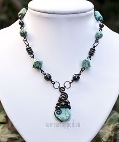 Beautiful turqoise and hematite -- I'd like to try to make that pendant...not sure if I could, though