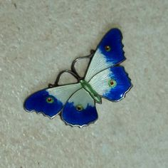 Blue, white, red and green enamel sterling silver butterfly brooch