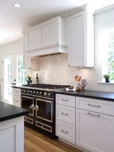 Hampton Design - kitchens - La Cornue CornuFe Range - Gloss Black, rustic wood floors, rustic hardwood floors, rustic kitchen floors, rustic...
