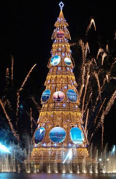 A Christmas tree is surrounded by fireworks during the lighting ceremony at Rodrigo de Freitas Lake, in Rio de Janeiro, Brazil, on Saturday, Dec. 2, 2006. The tree was decorated with 2.8 million light bulbs and was 82 meters (269 feet) tall.