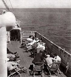 Third Class Passengers relaxing on the deck of a steamship of the Hamburg-American Line circa 1938.