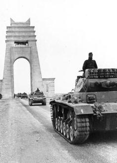 "Panzer III tanks on the Via Balbo at the ""Grand Arch of Sirte"" Sirte Italian Libya -1941."