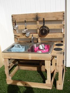 One of the Dads at my preschool made this outdoor kitchen for our playground! It is awesome and all recycled stuff-pallets, old sink and faucet, and pots and pans from yard sales. The kids love it! (Diy House For Kids) Diy Mud Kitchen, Outdoor Kitchen Bars, Outdoor Kitchen Design, Kitchen Ideas, Kitchen Designs, Mud Kitchen For Kids, Recycled Kitchen, Kitchen Sink, Wooden Pallet Furniture