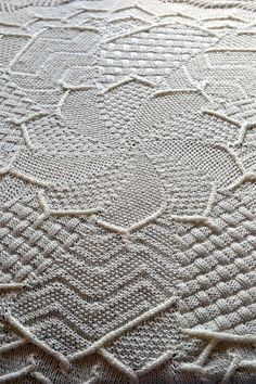 "Free Knitting Pattern for Sampler Flower Baby Blanket - Circular baby blanket knit with different textured stitches. Sport weight yarn. Approx. 36"" Diameter. Designed by Grid Mammal Crafts"
