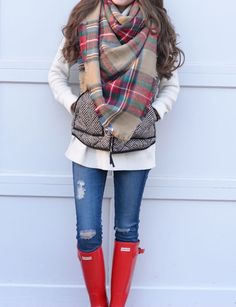 A fun and cute outfit it has great combination of colors and the vest brings out the colors of the scarf and shirt it makes the outfit come alive !!