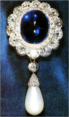Empress Marie Feodorovna's Sapphire Brooch Empress Marie Feodorovna (née Princess Dagmar of Denmark) was the wife of Alexander III of Russia. She received this brooch, an oval cabochon sapphire. Royal Jewelry, Gems Jewelry, Jewelery, Fine Jewelry, Antique Jewelry, Vintage Jewelry, Pearl Brooch, Diamond Brooch, Sapphire Diamond
