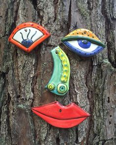 This Picasso-Style tree face is sure to bring a double-take and a smile when seen on your trees, fence, or wall. Very unique, hand made garden art. Hand made of white stoneware clay, I hand make the separate piece to be similar to some of the crazy Picasso facial features. Each piece is glazed in white, then I hand paint the bright colored glaze. Each Picasso face is unique. They make a great gift! Please keep in mind that the bright colored overglaze details are applied on top of the white…