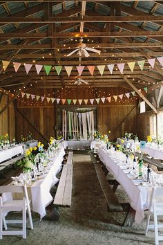 barn reception, photo by Sara Wilde http://ruffledblog.com/pucks-farm-wedding #weddingideas #barnwedding #bunting