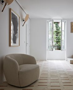 Photo by Real Living in Paris, France. Image may contain: living room, plant, table and indoor.