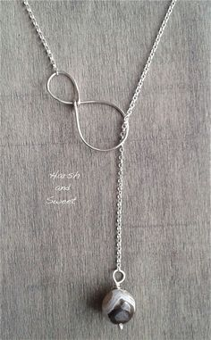 This minimalist infinity necklace is a simple, yet refined, addition to any outfit. Its brown lace agate bead features beautiful details and the infinity element is simple enough to allow the gemstone to shine. Handmade in sterling silver, the chain of this lariat necklace has links that will reflect the light and stand out while the agate bead with its intricate details is going to become an ine... *** Click image for more details. #Easycrafts