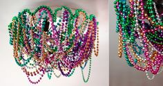 Mardi Gras bead chandelier - could be more tastefully done, but there is something to be said for the chaos that a bundle of mardi beads delineates into.