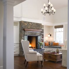 HEARTH ROOM:corner built in seating on either side of the fireplace with outside wall sconces