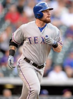 Jul 21, 2015; Denver, CO, USA; Texas Rangers left fielder Josh Hamilton (32) follows his fly ball in the first inning against the Colorado Rockies at Coors Field. Mandatory Credit: Ron Chenoy-USA TODAY Sports