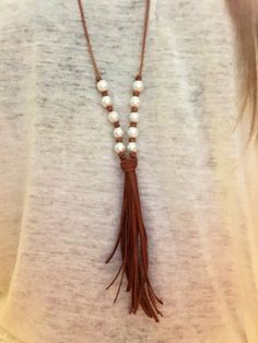 Leather and pearl tassel long necklace by DeepDownDixie on Etsy
