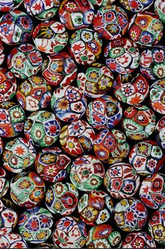 Millefiori Lentil Beads | One of the photos from Jack DeWitt beautiful series of old bead. Many of the photographs are beads and bead sample cards from the collection of John and Ruth Picard and can be seen at their bead museum in Carmel Valley California. | Jack offers these bead photo either as a blank cards with envelope, or some are also available as striking enlargements.