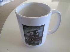 CHAIN OF SHADOWS promotional coffee cup.
