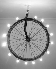 26. A LIGHT INSTALLATION ON A BIKE WHEEL - 26 Creative Methods Of Reusing Wheels In Your Design