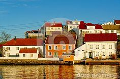 Colored and white houses port. Red roofs of old wooden houses. The distinctive buildings. On the island harbor area and summer houses. The old port on the fjord. Region of southeastern Norway. Summer Houses, Old Port, Wooden Houses, Red Roof, White Houses, Photo Colour, Norway, Buildings, Coast
