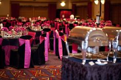 Black tablecloth & chair covers, purple flowers and bows