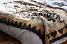 bed and native blanket
