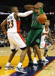 Ray Allen #20 of the Boston Celtics has the ball stolen by C.J. Watson #23 of the Golden State Warriors during an NBA game at Oracle Arena on…