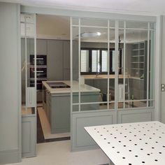 Luisa Olazábal-sage green-glass doors