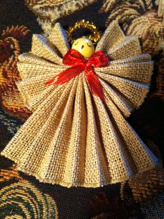 Angel in accordion folded Burlap With A Dashing Red Bow Handmade by marjorieanns Christmas Angel Crafts, Rustic Christmas Ornaments, Handmade Christmas Decorations, Christmas Love, Christmas Projects, Holiday Crafts, Handmade Angels, Burlap Crafts, Angel Ornaments