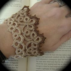 Tatted cuff bracelet...very pretty as is, in different colors, or as a jacket cuff. It's on my list of things to do!