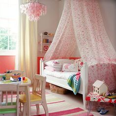 This is a perfect little girl's room. I love the canopy and the pink chandelier.
