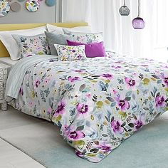 Refresh your bedroom with the vibrant look of spring with the bluebellgray Christine Comforter Set. Delicate watercolor flowers blossom on a soft, chalky mauve base to create a bouquet of beautiful colors for your bed.