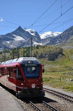 Bernina-Express of the Rhaetian Railway / Bernina-Express der Rhätischen Bahn unterwegs von Tirano über den Berninapass nach St. Moritz.