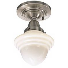 The classic schoolhouse style light fixture shines in this brushed nickel ceiling light.