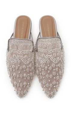b218b6d0709 This   Saptodjojokartiko   mule is rendered in tulle and features an  embroidered detail