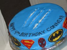Logan wants a superhero party. I'd need to add the Hulk and Ironman, but this looks simple enough, yet still super cute. Possibly add toy figurines to the top too.     Superhero Cake by All You Need Is Cake, via Flickr