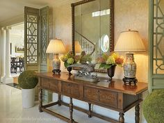 Foyer with antique table and screens and view into the dining area. Design by Wilson Kelsey Design
