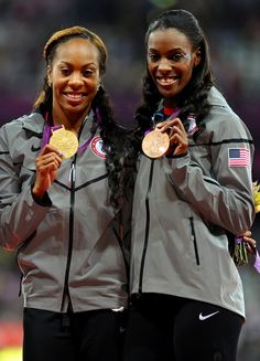 Gold medalist Sanya Richards-Ross and bronze medalist DeeDee Trotter of the United States pose on the podium during the medal ceremony for the Women's 400m Final on Day 9 of the London 2012 Olympic Games at the Olympic Stadium on August 5, 2012 in London, England.