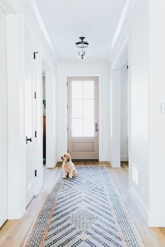 Great idea.. use tile to create a rug for an entry way. Great design and easy to clean