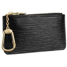 """Louis Vuitton Epi Leather Key Holder Noir M63802   This key pouch in Epi leather holds change and keys.It clips easily onto the D ring found in most Louis Vuitton handbags.  Epi leather discreetly stamped with the LV initials,tone on tone cross grain leather lining; Zipper closure; Key ring; Hooks onto the D rings found in most Louis Vuitton bags.  4.9"""" x 2.8"""""""