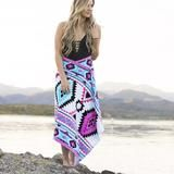 Classic Aztec print in bright colors - beach towel that buttons into a versatile cover-up. Simple Sarong in Tulum.
